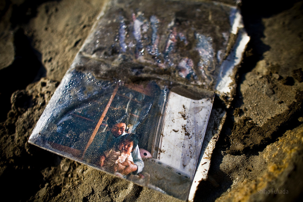 A photo album is seen in ruins of Rikuzentakata in Iwate prefecture, Japan, March 18, 2011.