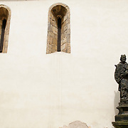Church of St. John at the Laundry in Prague with statue and two windows