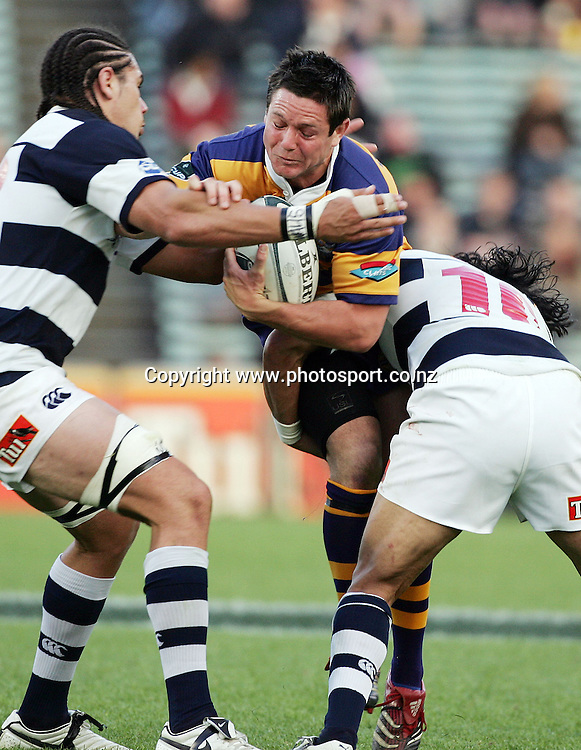 Mike Delany is lifted up by Tasesa Lavea and Kurtis Haiu during the Air NZ Cup rugby match between Auckland and Bay of Plenty at Eden Park, Auckland, New Zealand on 7 October, 2006. Auckland won the match 47 - 14. Photo: Hannah Johnston/PHOTOSPORT<br />