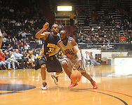 "Ole Miss guard Chris Warren (12) is defended by Murray State guard Jewuan Long (33) at the C.M. ""Tad"" Smith Coliseum in Oxford, Miss. on Wednesday, November 17, 2010."