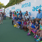 August 19, 2014, New Haven, CT:<br /> Connecticut Lieutenant Governor Nancy Wyman speaks with kids during a Girl Scout Night clinic on day five of the 2014 Connecticut Open at the Yale University Tennis Center in New Haven, Connecticut Tuesday, August 19, 2014.<br /> (Photo by Billie Weiss/Connecticut Open)