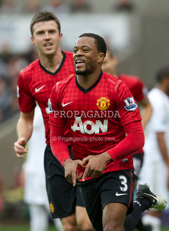 SWANSEA, WALES - Sunday, December 23, 2012: Manchester United's Patrice Evra celebrates scoring the first goal against Swansea City during the Premiership match at the Liberty Stadium. (Pic by David Rawcliffe/Propaganda)