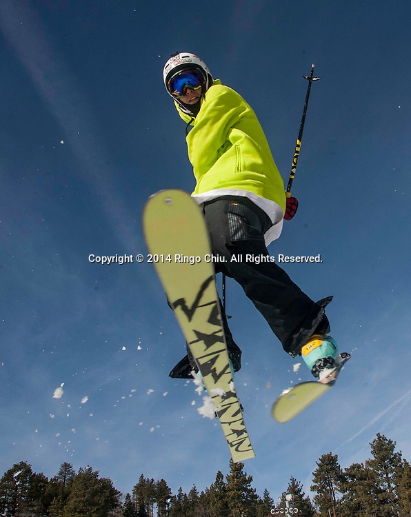 A skier shows off at Mountain High resort in Wrightwood , California Friday January 3, 2014. Warm temperatures hit Southern California, which stand in stark contrast to record snowfall in the east. According National Weather Service, a record high temperature of 68 degrees was set at Sandberg, California today. This tied the old record of 68 set in 2012.   (Photo by Ringo Chiu/PHOTOFORMULA.com)