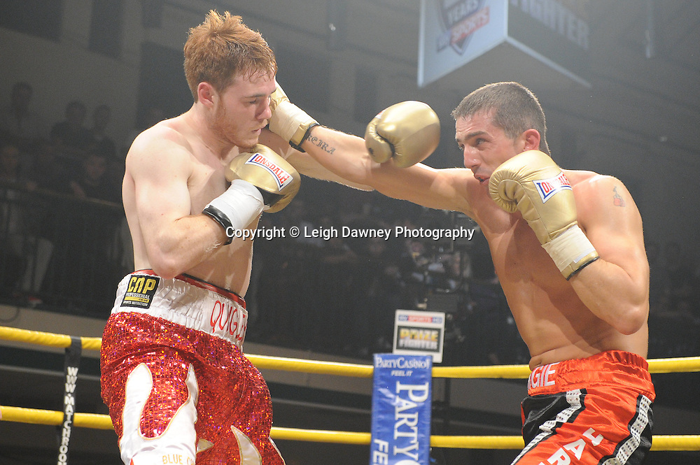 Nick Quigley (red/white shorts) defeats Stephen Harkin in Quarter Final Four of Prizefighter  - The Light Middleweights II. York Hall, Bethnal Green, London, UK. 15th September 2011. Photo credit: © Leigh Dawney.