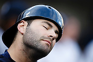 May 23, 2014; Detroit, MI, USA; Detroit Tigers catcher Alex Avila (13) stretches his neck in the dugout before the game against the Texas Rangers at Comerica Park. Mandatory Credit: Rick Osentoski-USA TODAY Sports