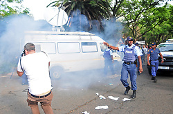 JOHANNESBURG, SOUTH AFRICA – APRIL 07: Police move in to disperse a small group of pro Zuma member from Black Land First (BLF) and anti Zuma protestors gathered outside the Gupta's Saxonwold residence call for President Zuma to step down, the Guptas through their businesses are accused of links to goverment officials and the president, in Johannesburg, South Africa, 07 April 2017. Businesses closed and South Africans from numerous political, religious, labour and civic groups gathered at central points across the entire country protesting against President Zuma's recent government reshuffle appointing 10 new ministers and 10 new deputy ministers including the axing of the finance minister. Photo: Dino Lloyd