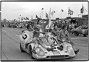 Daytona 24-Hour race • January 31, 1971 • Porsche 917K #2 F12 5-liter S  •  Pedro Rodriguez with crew, Jackie Oliver driving, coming down pit row after winning  •  Ermano Cuoghi on the right front fender, considered to be the best racing mechanic ever  •  Jose Ramirez behind him holding door  •  *J.W. Automotive Engineering entrant*