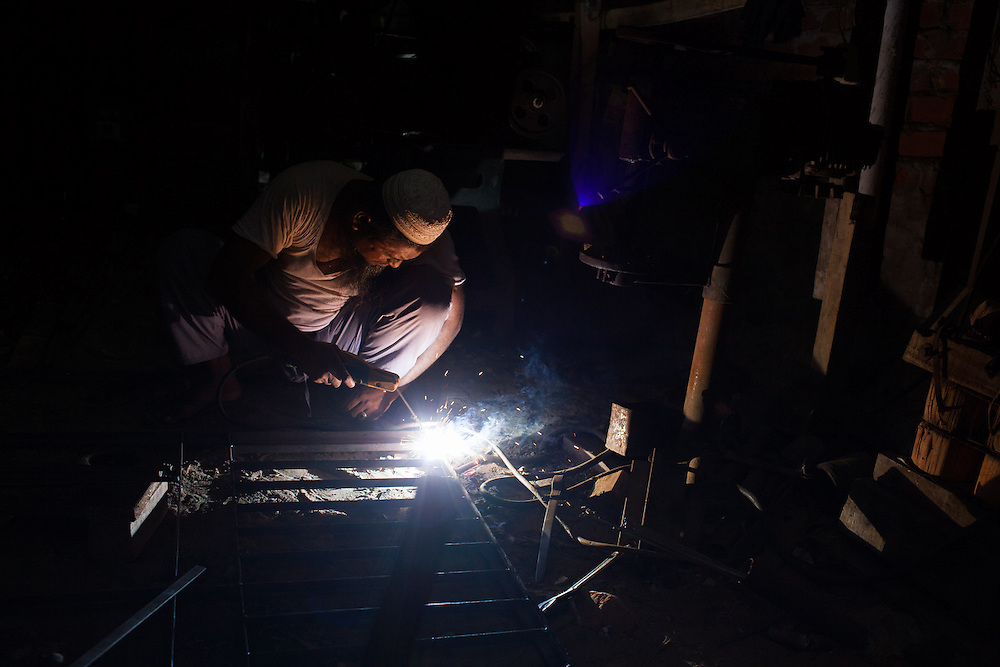 A welder works in his workshop in the southern town of Kuakata in Bangldesh