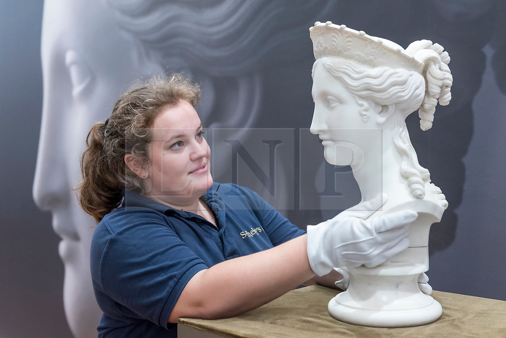 """© Licensed to London News Pictures. 29/06/2018. LONDON, UK. A staff member presents """"Bust of Peace"""" by Antonio Canova (Est. in excess of £1m).  Preview of Old Masters, British, Treasures, Sculptures and Ancient works at Sotheby's New Bond Street to be offered for sale on 3 and 4 July 2018.  Photo credit: Stephen Chung/LNP"""