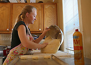 Co-owner Emily Hamilton works with some dough for kolaches at The Kettel House Bakery & Cafe in Marion on Tuesday, June 18, 2013.