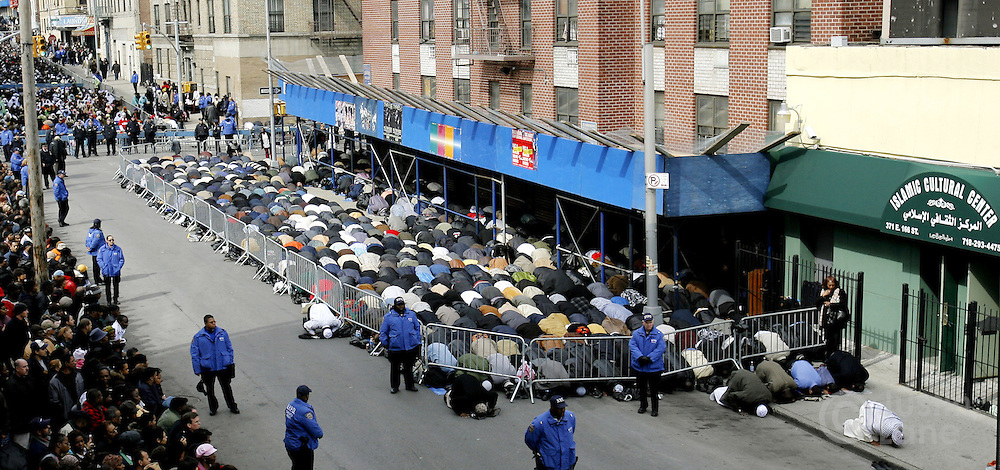 A large group of men pray on the sidewalk during funeral services at the Islamic Cultural Center for the ten people killed in a recent house fire in the Bronx, New York on Monday 12 March 2007. Of the ten people killed in the fire, 9 were children, and all were immigrants from Mali.