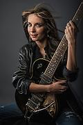 Beautiful woman with a Duesenberg Starplayer guitar