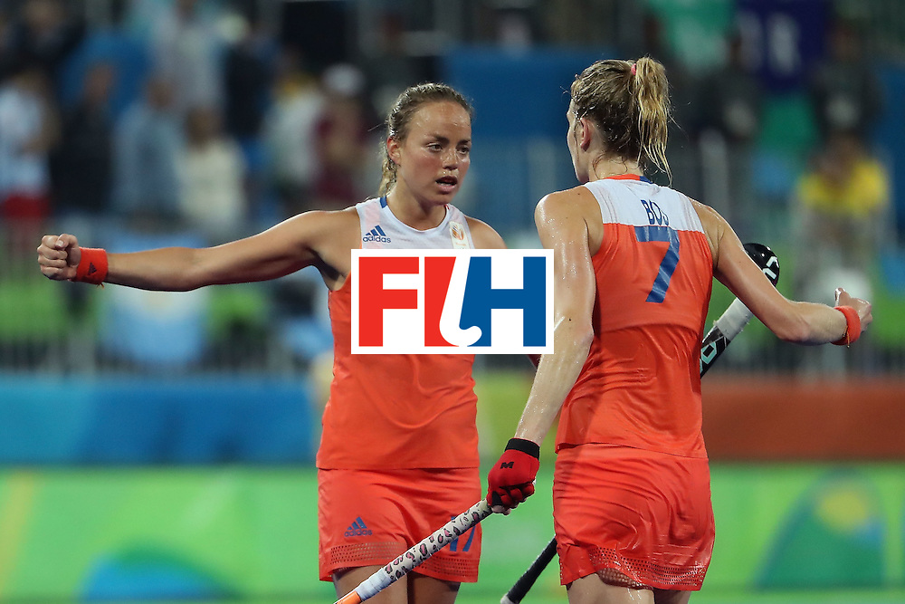 RIO DE JANEIRO, BRAZIL - AUGUST 15:  Maartje Paumen #17 and Willemijn Bos #7 of Netherlands celebrate after defeating Argentina 3-2 in the quarter final hockey game on Day 10 of the Rio 2016 Olympic Games at the Olympic Hockey Centre on August 15, 2016 in Rio de Janeiro, Brazil.  (Photo by Christian Petersen/Getty Images)