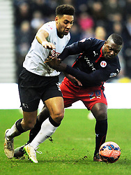 Derby Ryan Shotton battles with Reading Yakubu, Derby County v Reading, FA Cup 5th Round, The Ipro Stadium, Saturday 14th Febuary 2015