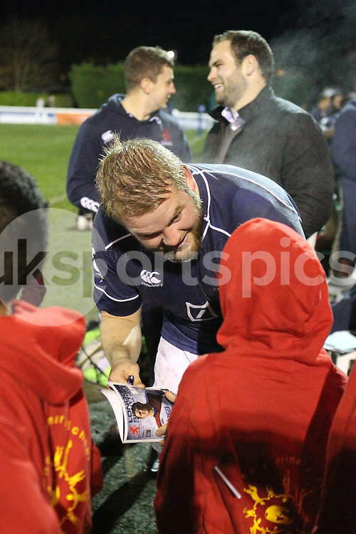 Mark Lilley signs an autograph for young fans after the Green King IPA Championship match between London Scottish &amp; Jersey at Richmond, Greater London on Friday 14th November 2014<br /> <br /> Photo: Ken Sparks | UK Sports Pics Ltd<br /> London Scottish v Jersey, Green King IPA Championship,14th November 2014<br /> <br /> &copy; UK Sports Pics Ltd. FA Accredited. Football League Licence No:  FL14/15/P5700.Football Conference Licence No: PCONF 051/14 Tel +44(0)7968 045353. email ken@uksportspics.co.uk, 7 Leslie Park Road, East Croydon, Surrey CR0 6TN. Credit UK Sports Pics Ltd