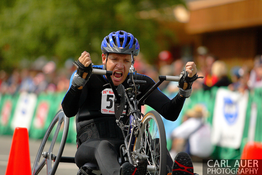 July 4th, 2006:  Anchorage, Alaska - Jonathan Merchant (582), a Army veteran from Fort Worth, Texas, makes a final push as he crosses the finish line of the 5k handcycle event at the 26th National Veterans Wheelchair Games..