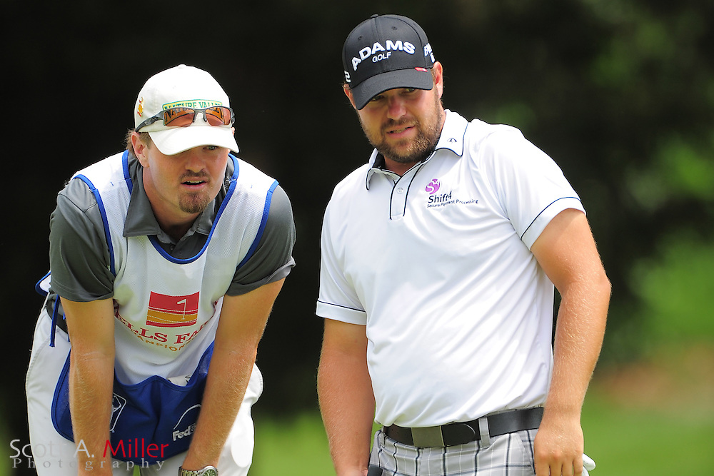 Ryan Moore and his caddie during the third round of the Wells Fargo Championship at the Quail Hollow Club on May 5, 2012 in Charlotte, N.C. ..©2012 Scott A. Miller.