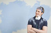 Man looking at half-painted wall