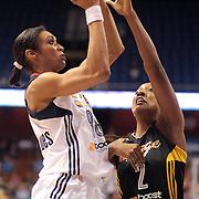 Iziane Castro Marques, Connecticut Sun, shoots over Candice Wiggins, Tulsa Shock, during the Connecticut Sun V Tulsa Shock WNBA regular game at Mohegan Sun Arena, Uncasville, Connecticut, USA. 2nd July 2013. Photo Tim Clayton
