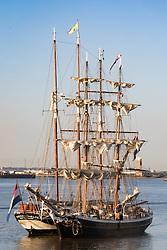 Woolwich, London, September 14th 2016. The afternoon sun illuminates the sfurled sails and masts of  tall ships gathered for the Sail Greenwich Festival 2016 on the River Thames at Woolwich.  &copy;Paul Davey<br /> FOR LICENCING CONTACT: Paul Davey +44 (0) 7966 016 296 paul@pauldaveycreative.co.uk