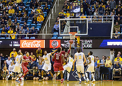 Jan 18, 2017; Morgantown, WV, USA; Oklahoma Sooners guard Jordan Woodard (10) shoots the go ahead basket in the lane during overtime against the West Virginia Mountaineers at WVU Coliseum. Mandatory Credit: Ben Queen-USA TODAY Sports
