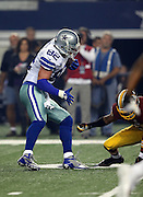 Dallas Cowboys tight end Jason Witten (82) dodges a defender as he catches a first quarter pass good for a first down on the Cowboys first drive during the NFL week 6 football game against the Washington Redskins on Sunday, Oct. 13, 2013 in Arlington, Texas. The Cowboys won the game 31-16. ©Paul Anthony Spinelli