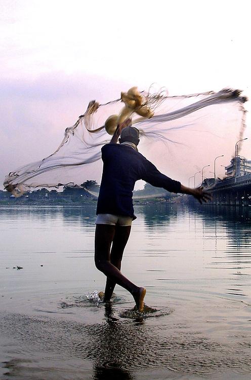 Benin November 27, 2001 - Beninese fisherman on the lake in northem of Cotonou