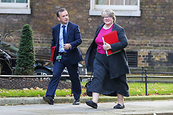 © Licensed to London News Pictures. 22/10/2019. London, UK. Secretary of State for Wales ALUN CAIRNS  (L) and  Secretary of State for Work and Pensions, Minister for Women And Equalities THÉRÈSE COFFEY (R) arrives in Downing Street to attend the weekly cabinet meeting. Photo credit: Dinendra Haria/LNP