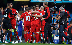 LONDON, ENGLAND - Saturday, October 31, 2015: Liverpool Lucas Leiva celebrates the 3-1 victory over Chelsea with Alberto Moreno and manager Jürgen Klopp after the Premier League match at Stamford Bridge. (Pic by Lexie Lin/Propaganda)