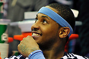 Jan. 28, 2011; Cleveland, OH, USA; Denver Nuggets small forward Carmelo Anthony (15) smiles from the bench during the fourth quarter against the Cleveland Cavaliers at Quicken Loans Arena. The Nuggets beat the Cavaliers 117-103. Mandatory Credit: Jason Miller-US PRESSWIRE