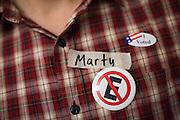 Marty Riker sports a No On Measure E pin in Milpitas, California, on November 4, 2014. (Stan Olszewski/SOSKIphoto)