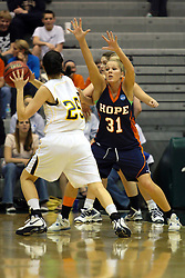 19 March 2010: Erika Bruinsma guards Caroline Bernal-Silva. The Flying Dutch of Hope College defeat the Yellowjackets of the University of Rochester in the semi-final round of the Division 3 Women's Basketball Championship by a score of 86-75 at the Shirk Center at Illinois Wesleyan in Bloomington Illinois.