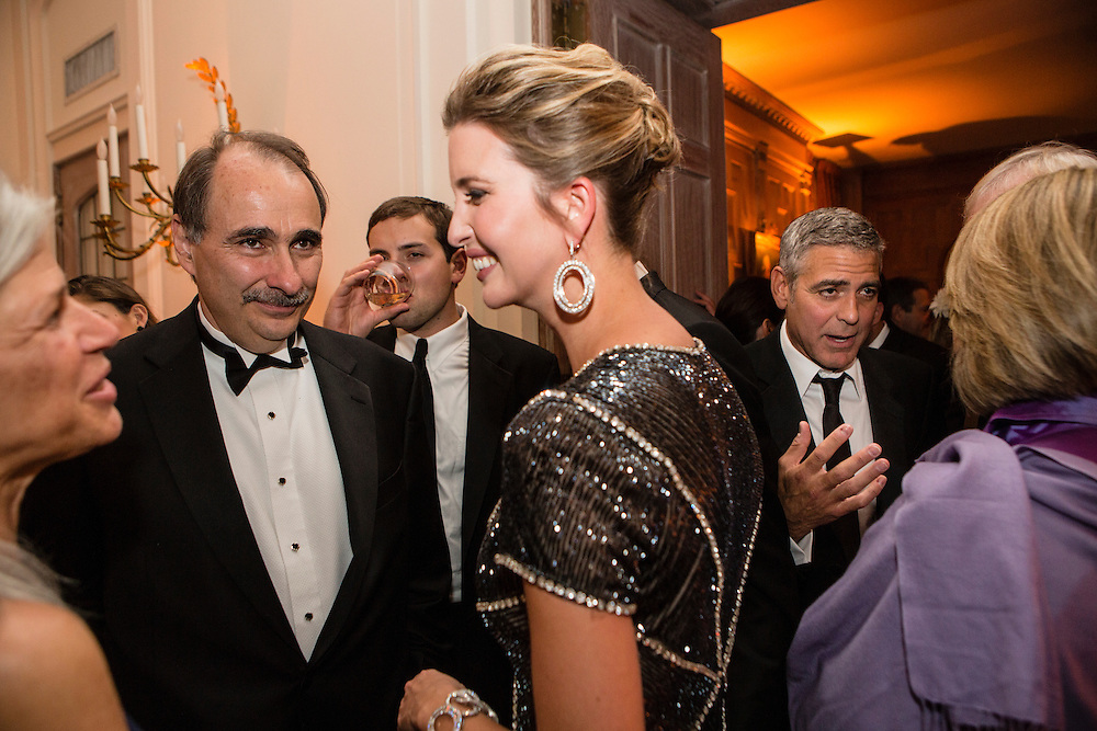 David Axelrod, left, and actor George Clooney, second from right, attend the Bloomberg Vanity Fair White House Correspondents' Association dinner afterparty at the residence of the French Ambassador on Saturday, April 28, 2012 in Washington, DC. Brendan Hoffman for the New York Times