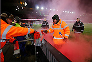 Stewards dealing with a flare thrown by celebrating Middlesbrough fans  during the EFL Sky Bet Championship match between Middlesbrough and Leeds United at the Riverside Stadium, Middlesbrough, England on 2 March 2018. Picture by Paul Thompson.