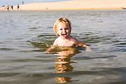 2 year old girl playing in Currimundi Lake, Sunshine Coast, Queensland, Australia