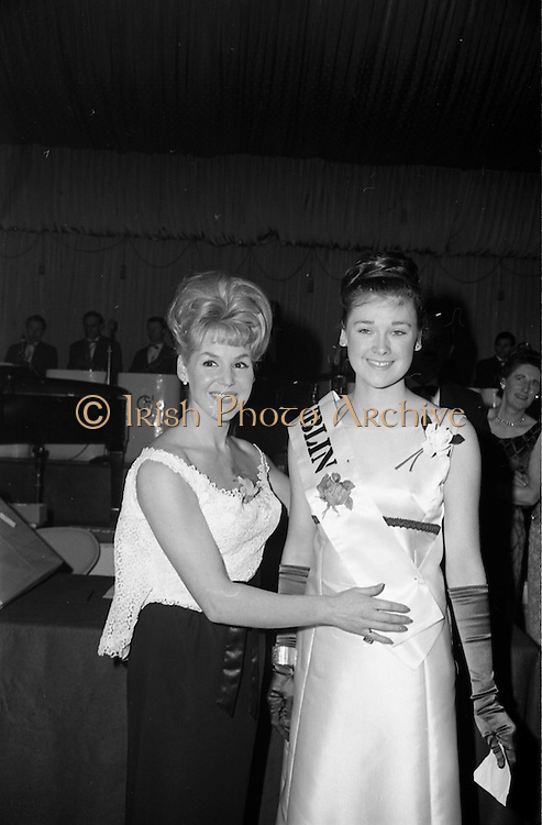 28/04/1965<br /> 04/28/1965<br /> 28 April 1965<br /> Festival of Kerry Dublin Ball at the Gresham Hotel, Dublin. Photo shows winner Miss Irene Courtney (right) receiving her award as Dublin Rose, from Frances McDermott (Judge).