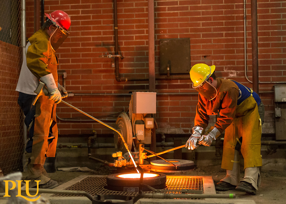 Spencer Ebbinga and crew pouring a bronze sculpture in the PLU foundry of Martin Luther for the 500th anniversary of the Reformation, Thursday, June 1, 2017. (Photo: John Froschauer/PLU)