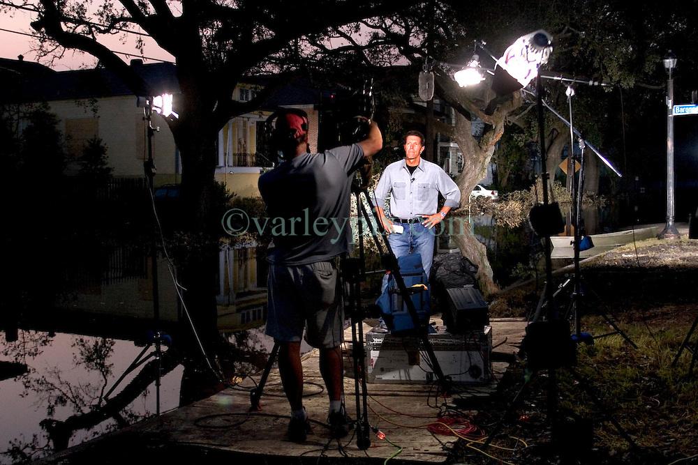 05 Sept  2005. New Orleans, Louisiana. Post hurricane Katrina.<br /> NBC anchor prepares to go live on air from Louisiana Street.<br /> Photo; ©Charlie Varley/varleypix.com