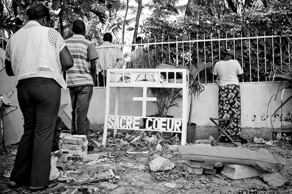 People pray at Sacre Coeur church, which was destroyed during the recent earthquake in Port-au-Prince, Haiti.
