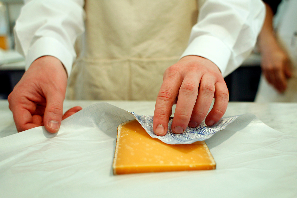 ROSLINDALE, MA--March 3, 2007--Aged gouda from holland being wrapped for a customer at the Boston Cheese Cellar...GLOBE PHOTO BY ZARA TZANEV