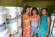 Njideka Harry (left), director of Youth for Technology, pictured here with Chika (middle) and one of her staff. <br /> <br /> Chika Chukwu set up and runs Decency Paints, which sells paint.<br /> <br /> Chika set up her business just over a year ago. The biggest thing that she has learnt from the Youth for Technology training is about managing and investing money. She used to think you needed lots of money to grow the business but now understand you can invest small amounts too.