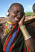 Africa, Tanzania, members of the Datoga tribe Woman in traditional dress, beads and earrings. Beauty scarring can be seen around the eyes, April 2006