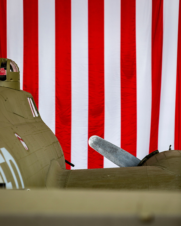 A WWII B-17 bomber, photographed with the American flag in the background during the 2019 Veterans Day event at Delta Tech Ops at Atlanta's Hartsfield-Jackson International Airport.<br />
