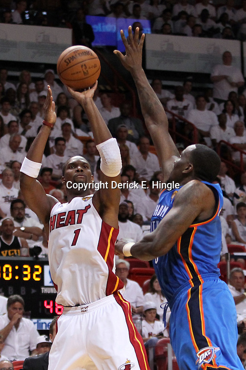 Jun 17, 2012; Miam, FL, USA; Miami Heat power forward Chris Bosh (1) shoots against Oklahoma City Thunder center Kendrick Perkins (5) during the third quarter in game three in the 2012 NBA Finals at the American Airlines Arena. Mandatory Credit: Derick E. Hingle-US PRESSWIRE