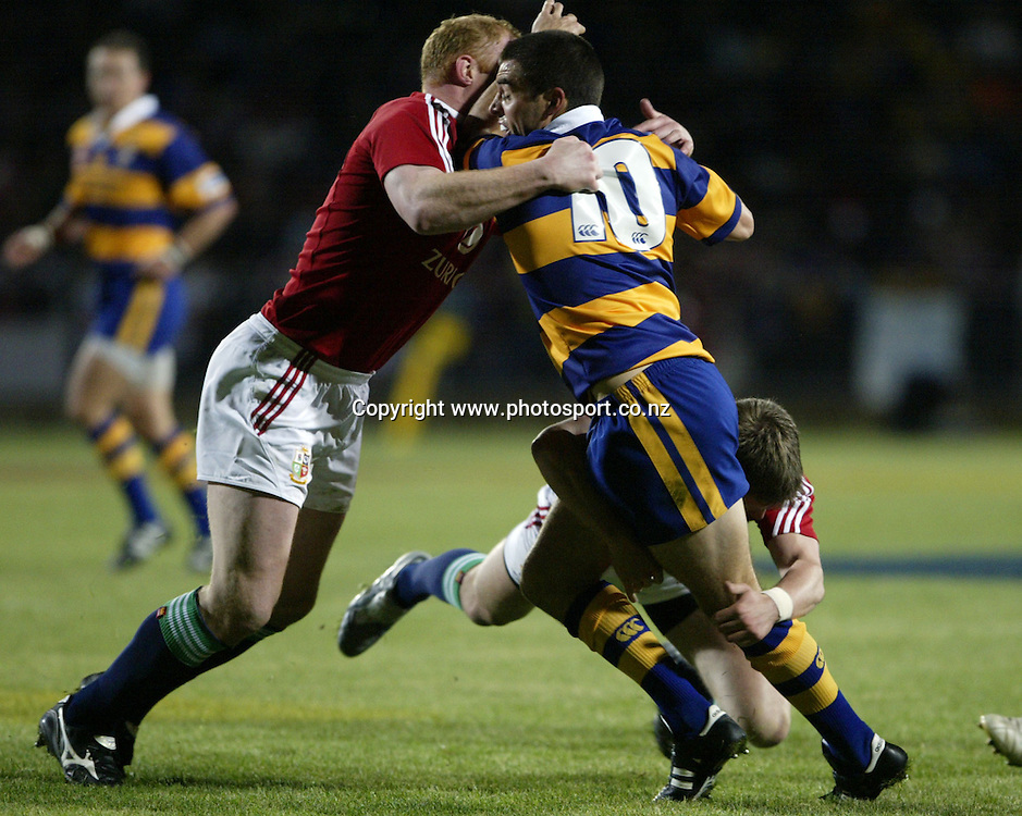 BOP's Murray Williams is tackled by Lions flanker Martyn Williams during the British and Irish Lions v Bay of Plenty rugby match at Rotorua International Stadium, Rotorua, New Zealand on Saturday 4 June, 2005. Photo: Michael Bradley/PHOTOSPORT<br /><br /><br /><br />125716