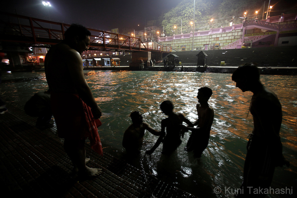 Hindu devotees take dip in the holy Ganges River during Kumbh Mela in Haridwar, northern India on January 2010. Hindus believe that bathing in the Ganges during the festival, the largest Hindu gathering in the world, cleanses them of sin..Photo by Kuni Takahashi