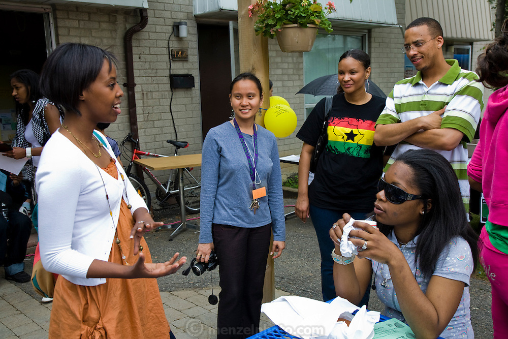 Muna Ali, at left, a Somali student living in Scarboro, Ontario, Canada attends a party at a housing project in East Scarboro.