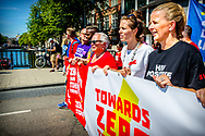 AMSTERDAM - Princess Mabel walks  along with AIDS activists in a protest march in the center of Amsterdam. With this they call attention to access to HIV medicines and discrimination and stigmatization of people living with HIV. The march is at the same time the start of AIDS2018, the 22nd edition of the largest congress in the world in the field of health. copyright robin utrecht