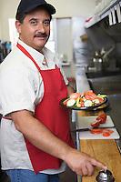 Portrait of man working in restaurant kitchen