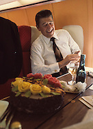 Candidate Reagan laughs at dinner on the United Airlines charter during the Reagan campaign fro president in 1976..Photograph by Dennis Brack bb 34